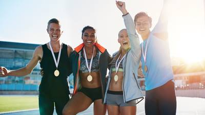 Cheering athletes with medals