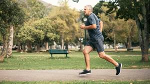 Male jogger running in a park