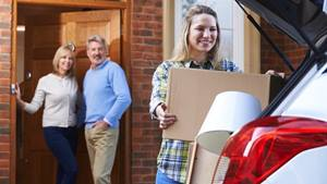 High school graduate packing up the car to leave for college.